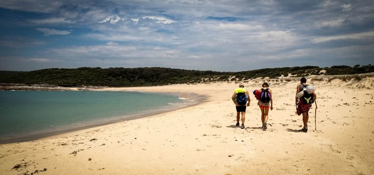 Top 6 Sydney Camping Escapes (by Public Transport), Henry Brydon, Royal National Park, beach, hikers, ocean, sand, sky