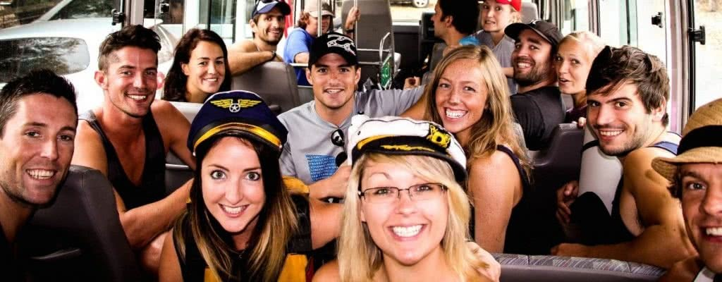 Best Weekend Adventure Getaways for Mates, Henry Brydon, sailor hats, smiles, group shot on the bus, friends, crew