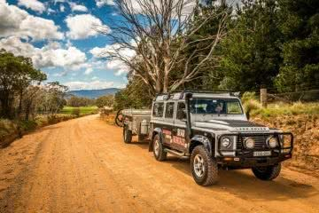 The Ultimate Land Rover Road Trip Around Australia Henry Brydon, land rover defender, camper trailer, dirt road, tree, bush