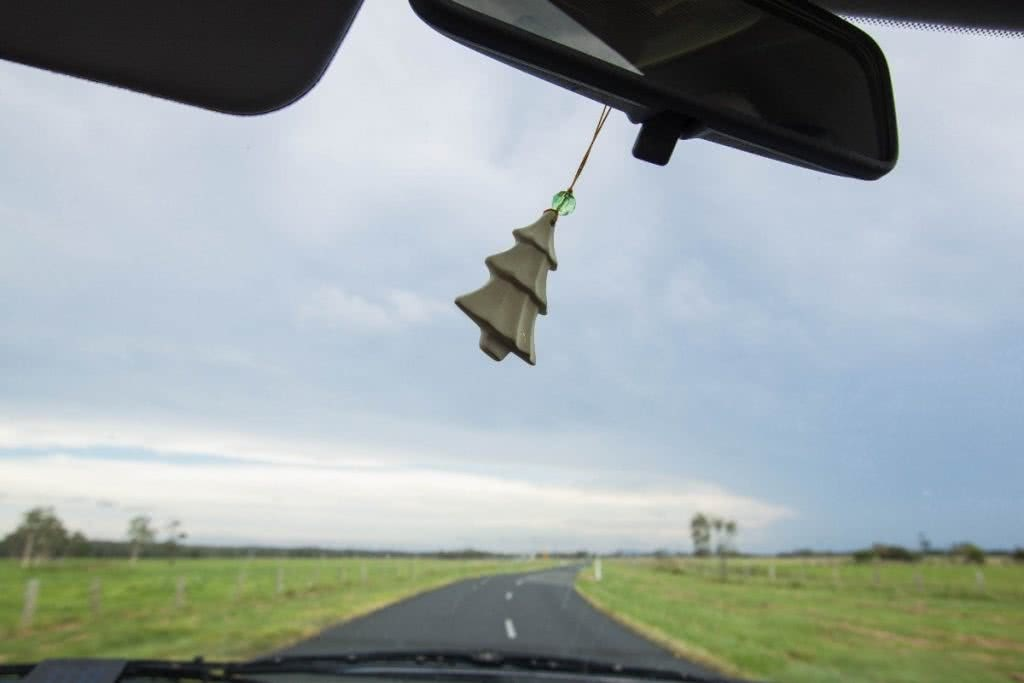 Searching for Alternative Australia // Part 1 Serena Renner, rear view mirror, christmas ornament, road ahead, fields, sky