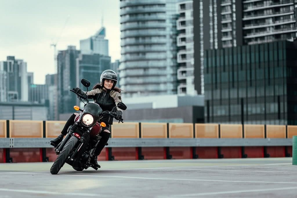 Another Urban Adventure // Melbourne (VIC), Henry Brydon, couple, rooftop, motorbikes, car park, CBD, woman, turning, rider