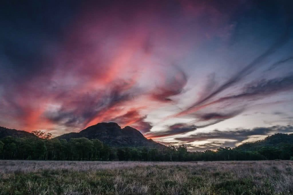 Trekking the Warrumbungles // Macha Tor and Grand High Tops (NSW), Harry Candlin, Split Rock, sunset, clouds, swirls, plain, hillside, peak