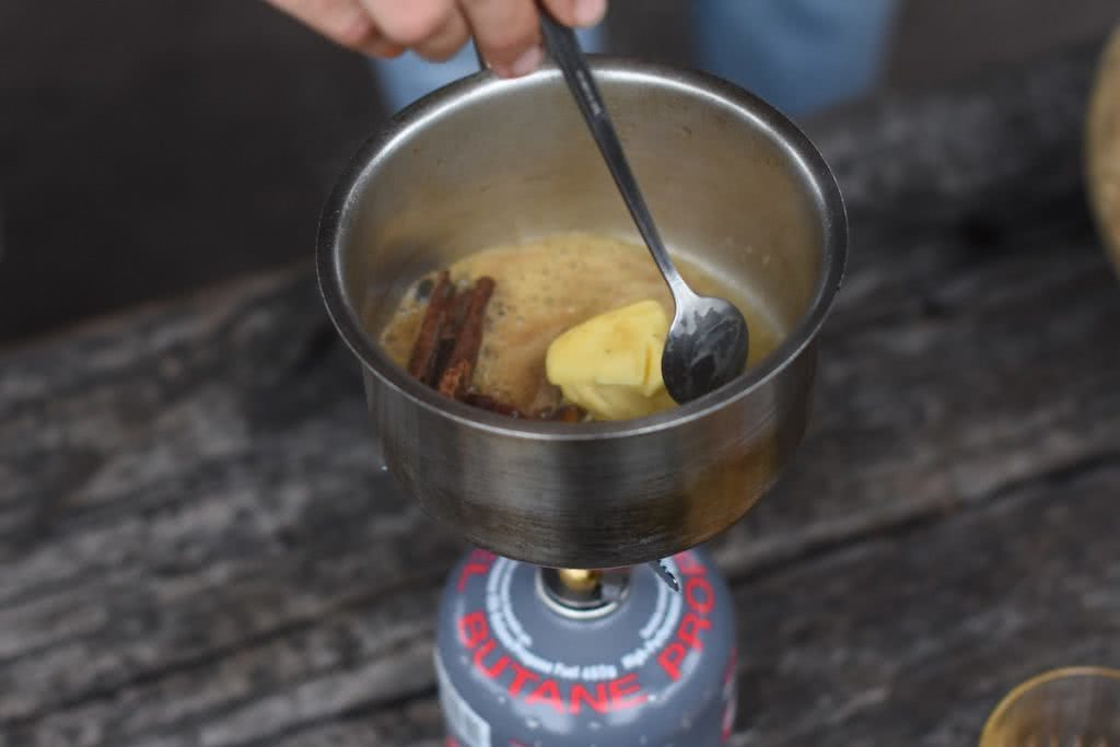 Winter Campfire Cocktails, Henry Brydon, butter, cinnamon, spoon, stove, pan