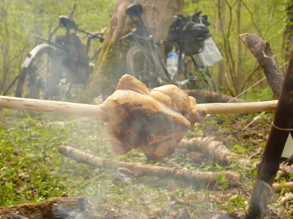 Essential Gear for Bikepacking Adventures, Henry Brydon,bikes, roast chicken on a spit, campfire, trees