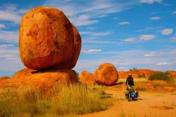 Essential Gear for Bikepacking Adventures, Henry Brydon,bike, person, red rock, blue sky, grass, outback