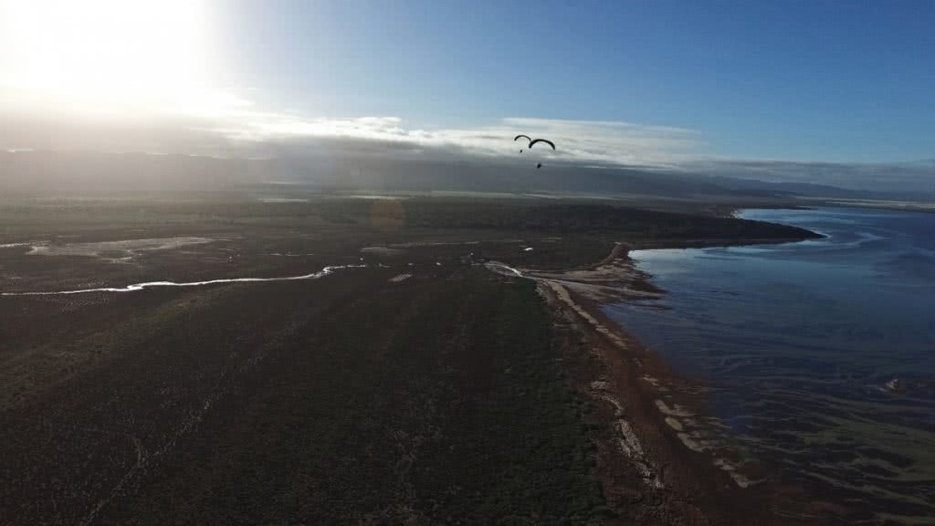 The Twins who Flew to the Australian Red Pole Henry Brydon, paramotors, water's edge, aerial photography, sunburst, river