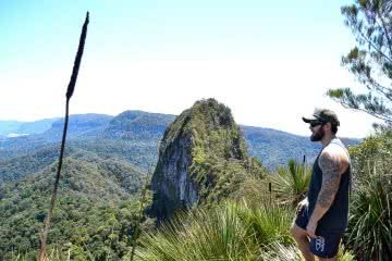 A Gem by the Glitter City Mt Cougals (QLD) Dan Parkes, man, mountain, grass tree spear