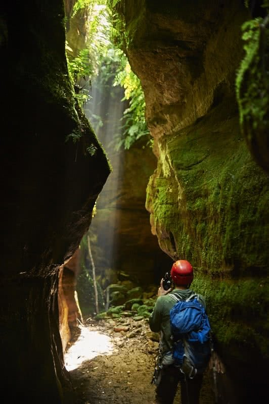 The Light At The Middle Of The Tunnel // Starlight Canyon (NSW) GUS ARMSTRONG Starlight Canyon, moss, rock face, ferns, climber, helmet, backpack, camera