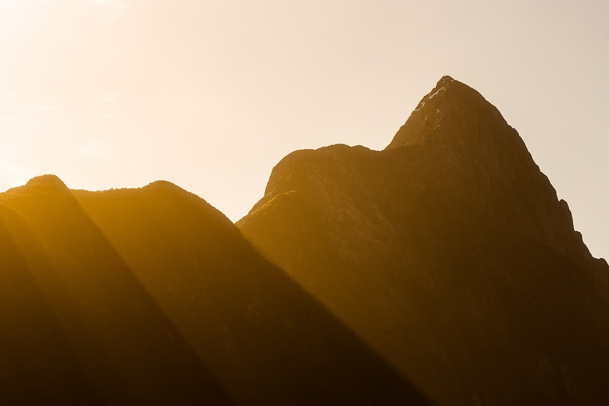 By Land And By Sea // Te Anau to Milford Sound (NZ) Liam Hardy, mountains, sunrise, haze, orange glow