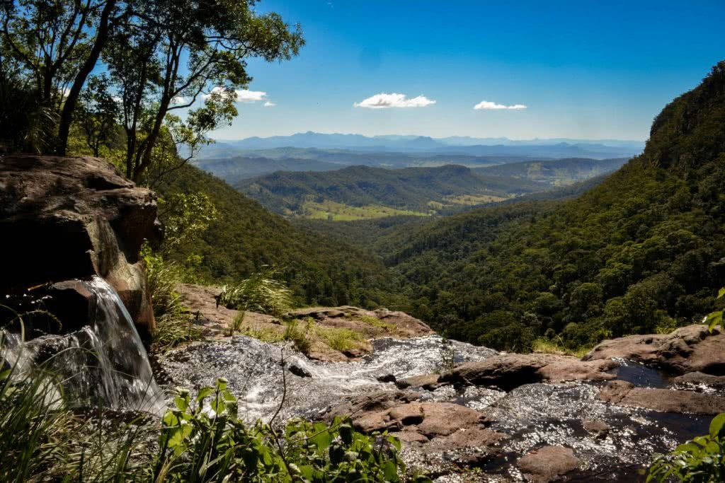 Lisa Owen_BestBeginnerHikesBrisbane_MoransFalls, Waterfall, mountains, horizon, tree, sky