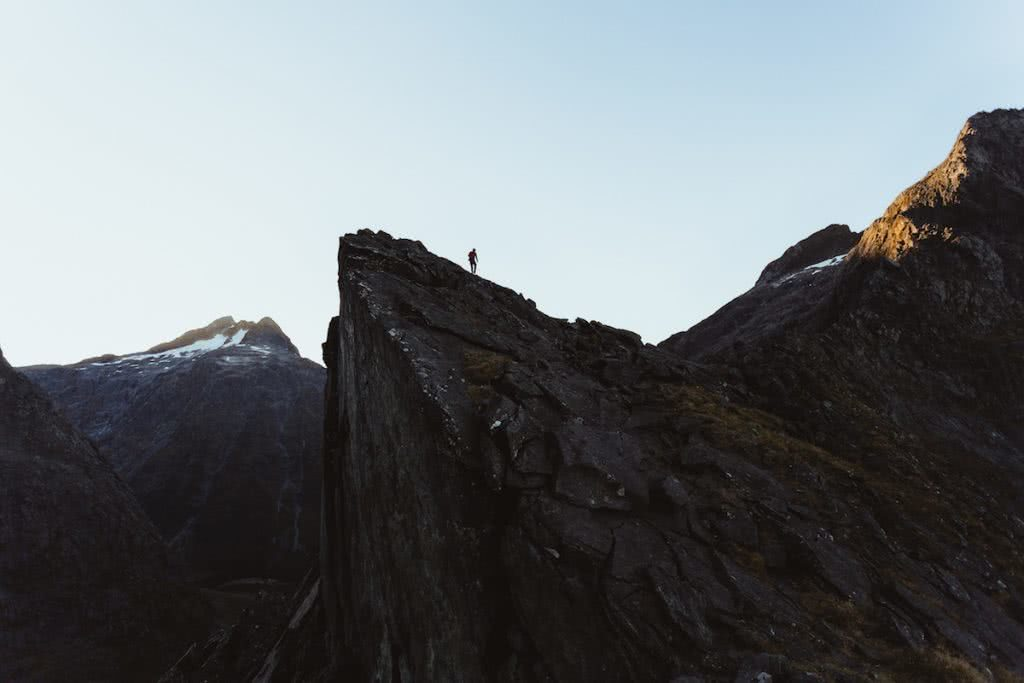 Want To Be An Adventure Photographer? gareth mcguigan adventure photography mountain man jumping