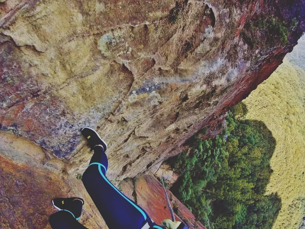 HIGH ABOVE THE TREE TOPS ON MALAITA WALL (NSW) Natalie Hardbattle View of the rockface, legs, climber, wall, sandstone cliff