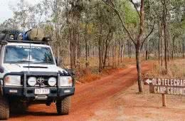 The Old Telegraph Track Cape York Peninsula NT, Grace and Brenton Kelly, 4WD, tyres, dirt road, sign, red dirt, trees
