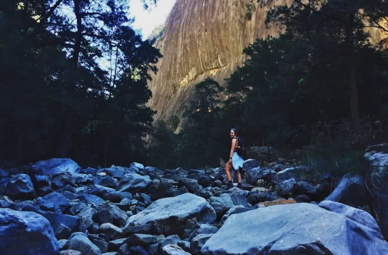 An Easy-Access Canyon Adventure // Bungonia Slot Canyon (NSW), Natalie Hardbattle, boulders, hiker, trees, valley