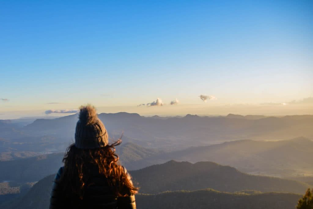 WAE_Sunrise View over to Lamington National Park Why I wake Up At 2am Every Weekend Lisa Owen, woman, bobble hat, down jacket, clouds