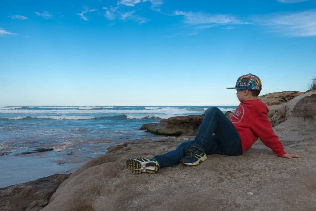 A Family Adventure Among The Burrawangs // Conjola Beach (NSW) drone, Melissa Bowyer, kid, cap, ocean, rocks