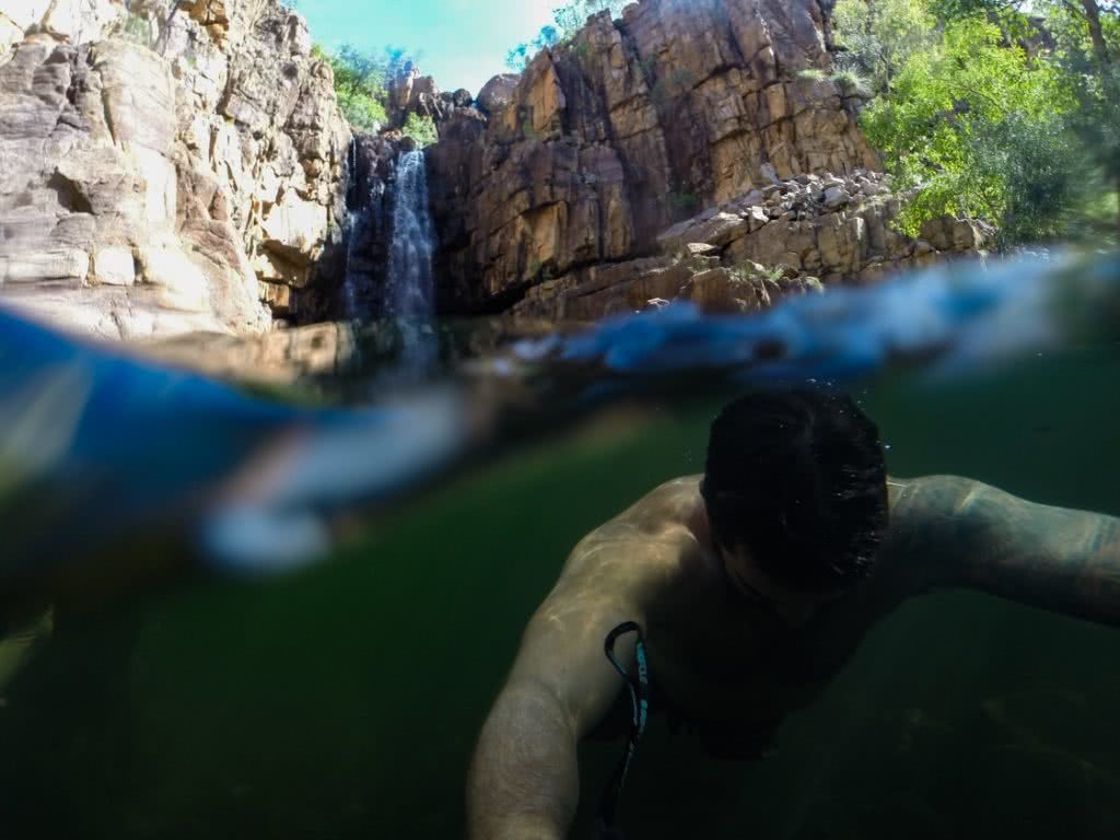 Stomping The Gorge // Nitmiluk National Park (NT) Dan Parkes, waterfall, bush, red rocks, trees, lily ponds, underwater, man swimming