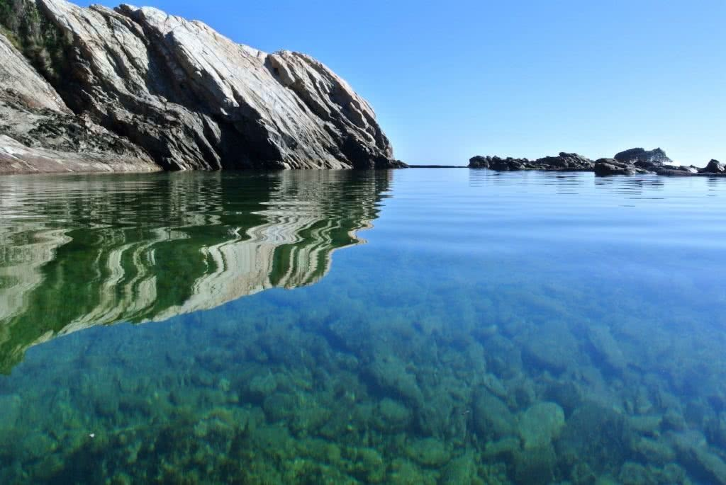 Where Land Meets Sea // 6 Rock Platforms To Explore Along The South Coast (NSW), Cara van Wyk, Blue Pool Bermagui, green, clear water, reflection, sky, hero