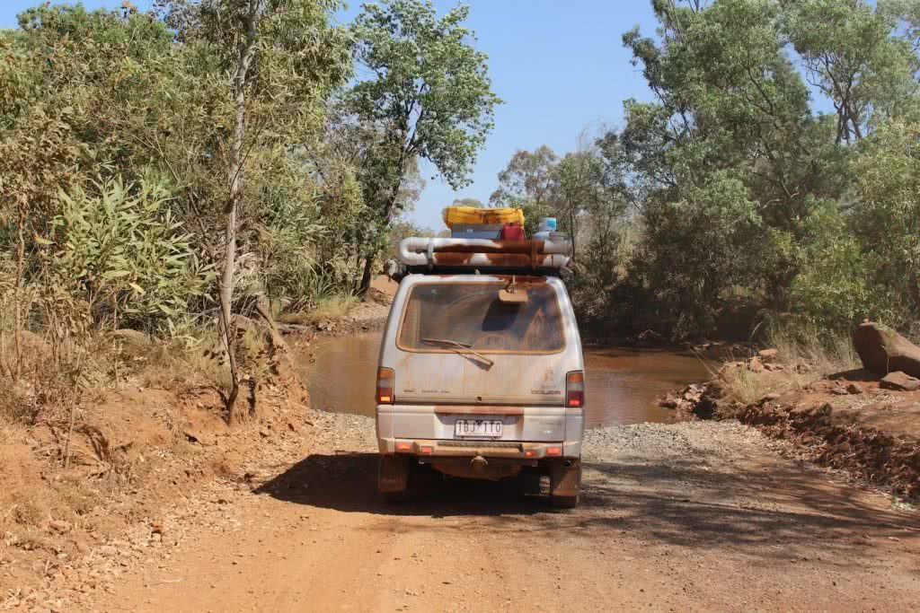 Red Dust // A Journey Along The Gibb River Road (WA) Ashlee Kehoe, van, dirt road, dust, trees, roofracks