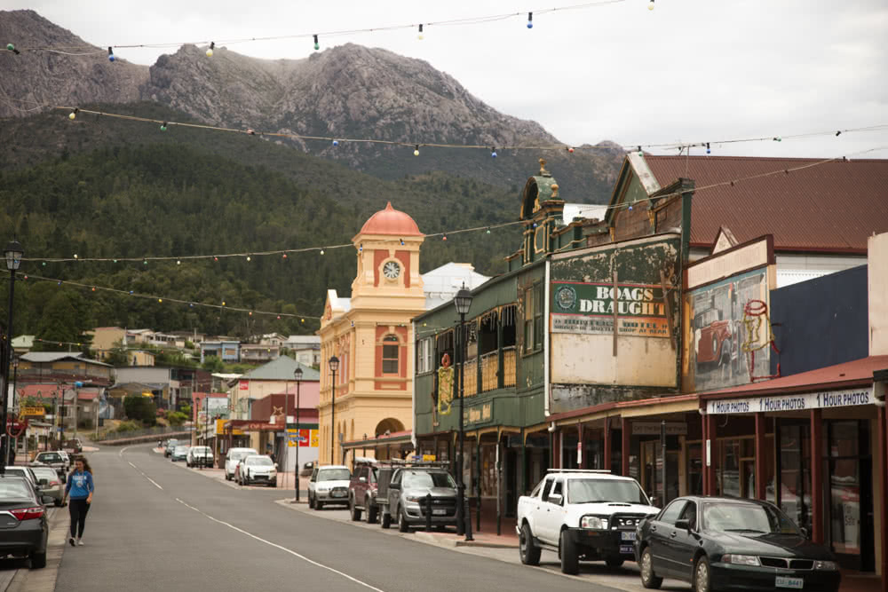12 Things To Do On Tassie's West Coast, photo by Nick Green, Queenstown Tasmania, mountains, town, street, cars, light, shops