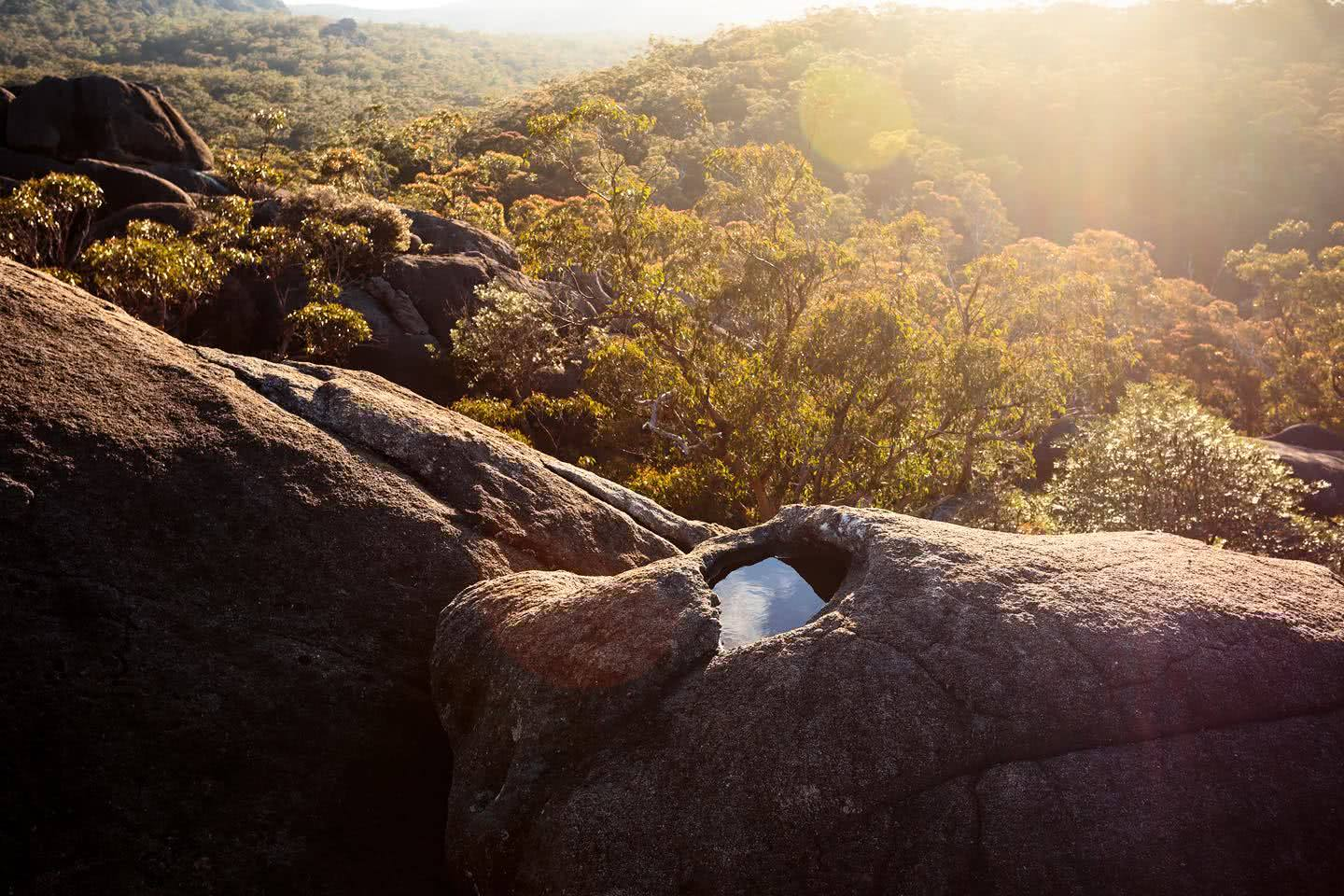 liam hardy, woolpack rocks, cathedral rocks national park, boulders, sunset, water, lens flare