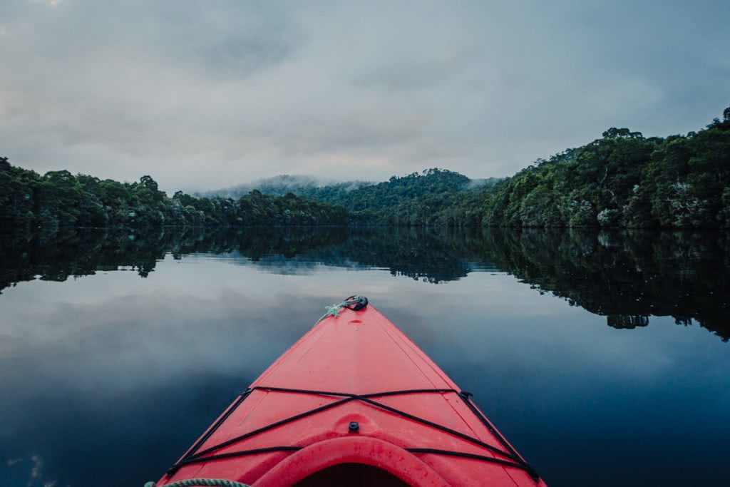 12 Things To Do On Tassie's West Coast, photo by Henry Brydon, kayak, river, forest, cloud, reflection, Corrina Kayaking