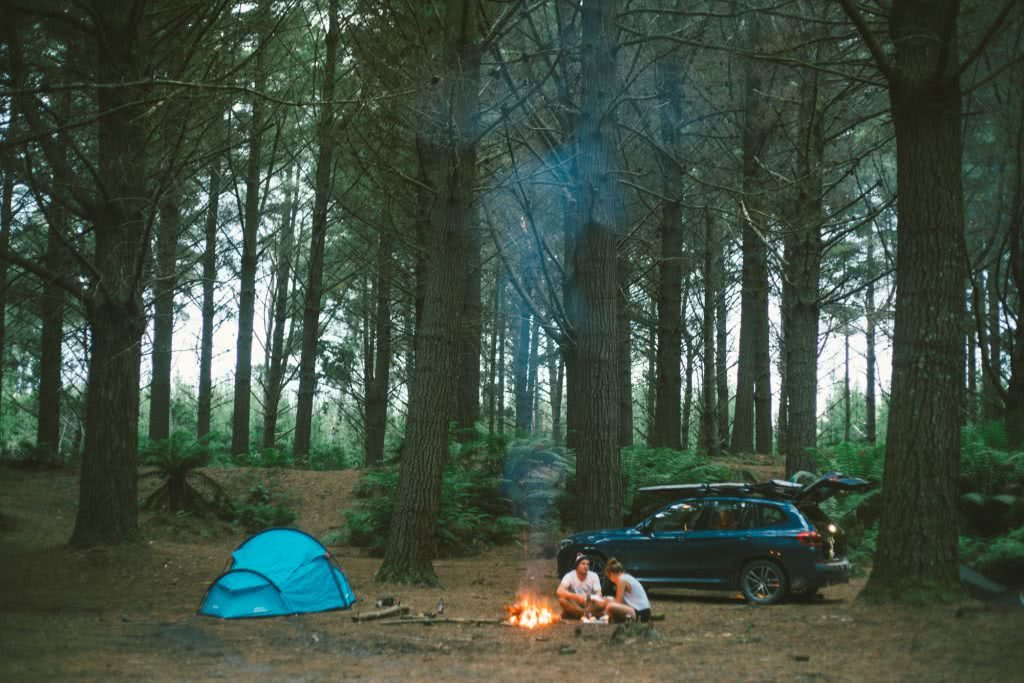 12 Things To Do On Tassie's West Coast, photo by Mitch Cox, Pine Forest, camping, tent, people, car