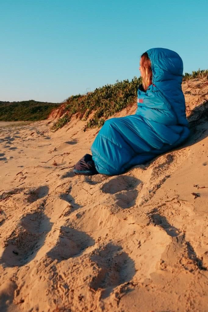 Blackwolf Hiker 500 Sleeping Bag // Gear Review, Caleb Hindley, woman, blue, hat, beach, sand dune, view, looking out