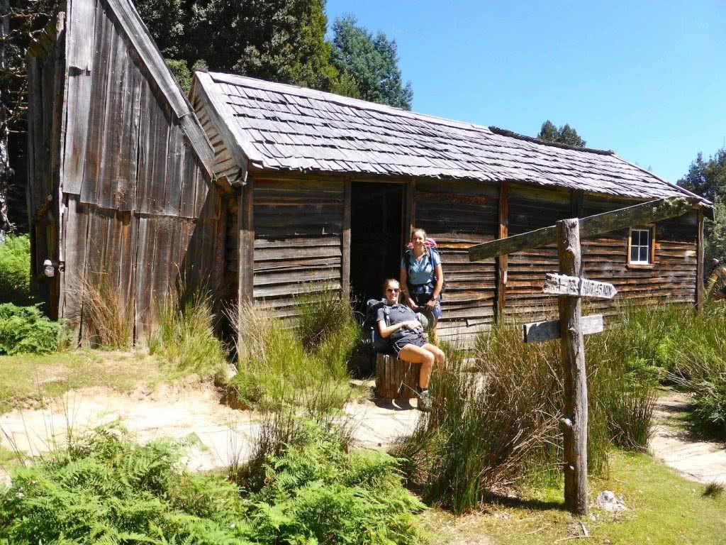 Highlights Of The Overland Track (VIC) Ducane Hut - Sarah Barlow, Photo Jo Barlow, hikers, signpost, rest, seat