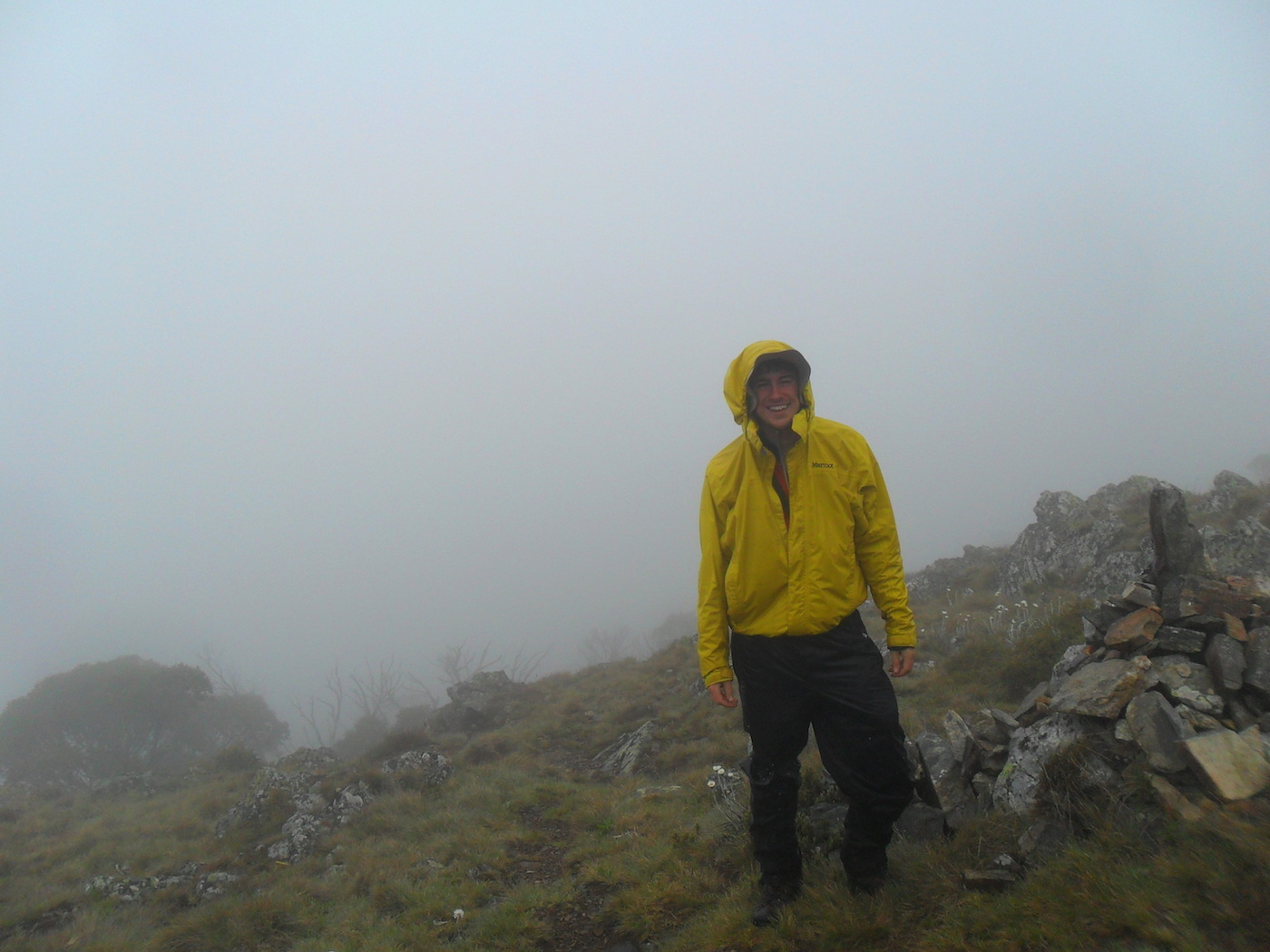 Welcome to Mt Jagungal (We Got Mist and Rain) // Kosciuszko NP (NSW), Sam Christie, mist, yellow, rain jacket, hillside