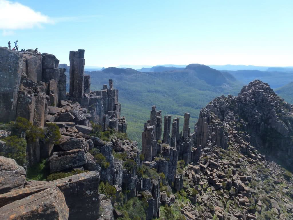 Highlights Of The Overland Track (VIC) The Acropolis - Sarah Barlow, rock formations, columns, group of hikers, rest stop with a view