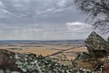 Lion Of The Plains// Rocking Out At The Rock (NSW), Cara Van Wyk, View across the farmland, fields, plains, rock, clouds, sky, horizon