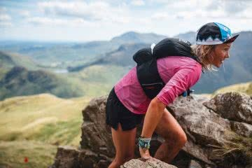 Meet Lucy Bartholomew // A Plant-Based Ultramarathon Champ, Tim Ashelford, runner, rocks, view, smile, scafell2