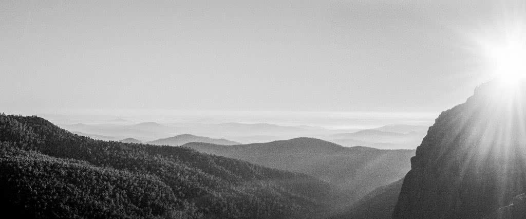 A Blast Up Booroomba Rocks // Namadgi NP (ACT), Dan McInnes, mountains, range, black and white, distance, view, sunburst, panorama, hero