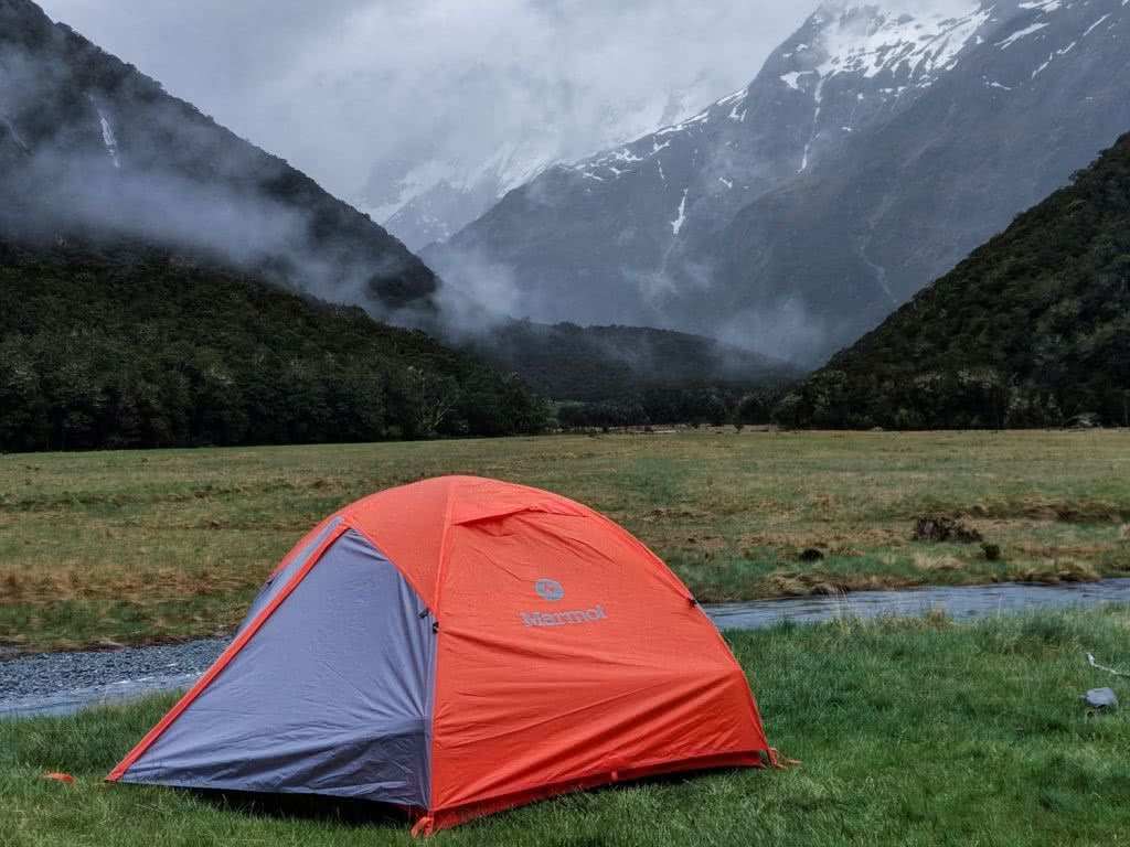 Soggy, Snowbound And Stoked // Routeburn Track (NZ), Rachel Dimond, Day 1 - Routeburn Flat campsite, tent, mist, low cloud, mountains, river