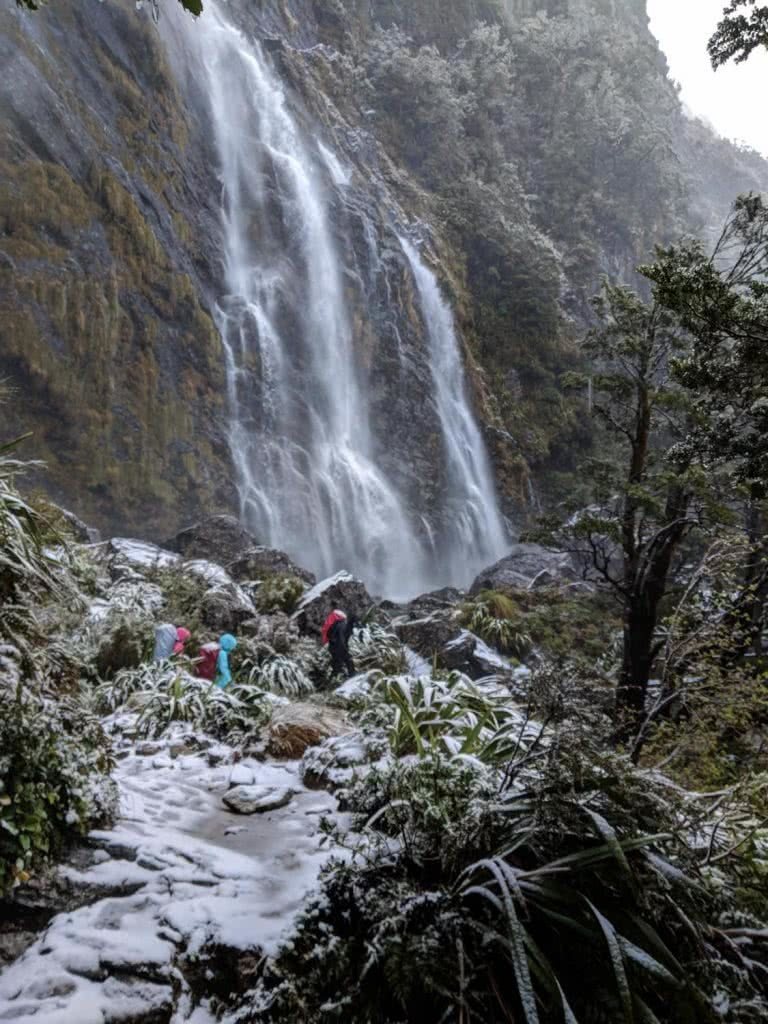 Soggy, Snowbound And Stoked // Routeburn Track (NZ), Rachel Dimond, Day 3 - Earland Falls, waterfall, waterproofs, mountains