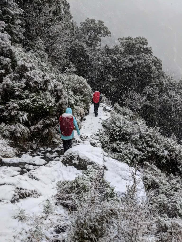 Soggy, Snowbound And Stoked // Routeburn Track (NZ), Rachel Dimond, Day 3 - The snow storm, hikers, trail, mountainside