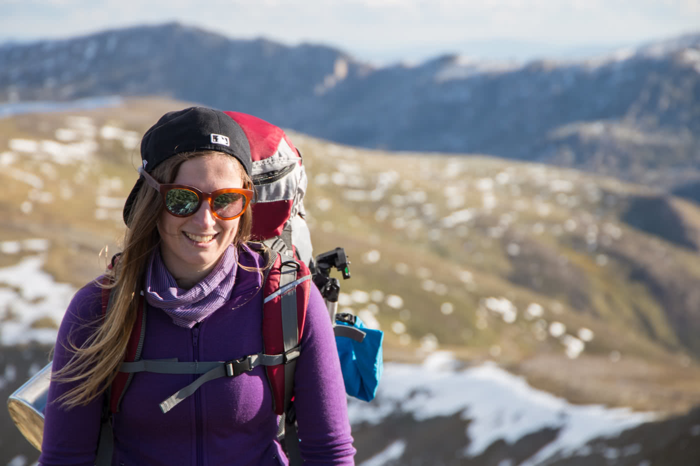 Rachel Dimond // Explorer Of The Month - March '18, Rachel - Kozzi, woman, hiker, backpack, sunnies, purple, snow, kosciusko