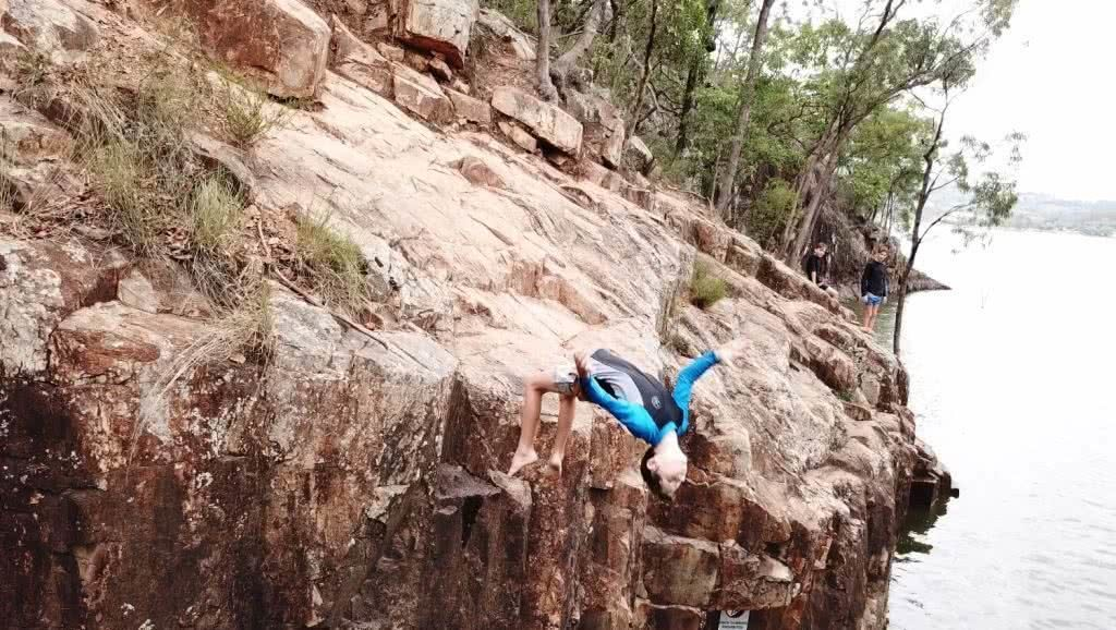 Rock Jumps At A Secret Gorge // Lake Moogerah (QLD), Kate Bennie, cliff jump, wetsuit, rocks