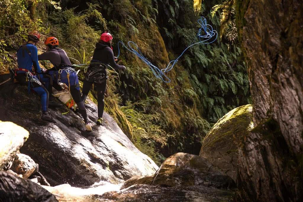 Ode To The River // Canyoning And Packrafting In New Zealand, Xavier Anderson, throwing rope, boulders, rocks, helmets