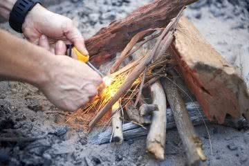 How To Make An Awesome Campfire Without Matches, photo by Neil Massey, fire, wood, sticks, fire pit, hands