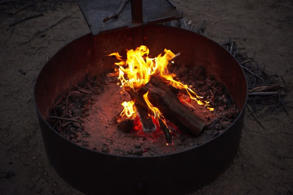 How To Make An Awesome Campfire Without Matches, Neil and Gabbi Massey, fire pit. flames, wood