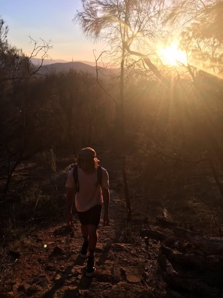Saturday Night In The City // Mt Majura Sunset Hike (ACT), Mattie Gould, Hike up, sunset, backpack, hazy, backlit