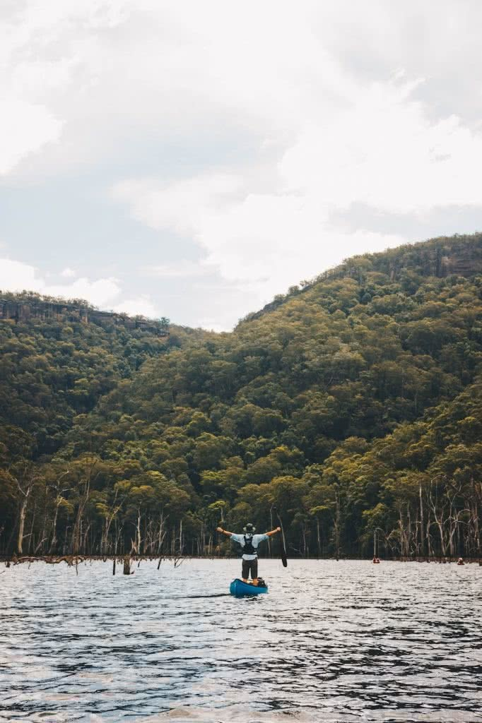 When Everything Flows // Kangaroo Valley Canoeing Escape, Aron Hailey, joy, canoe, river, awe, arms out, trees, forest