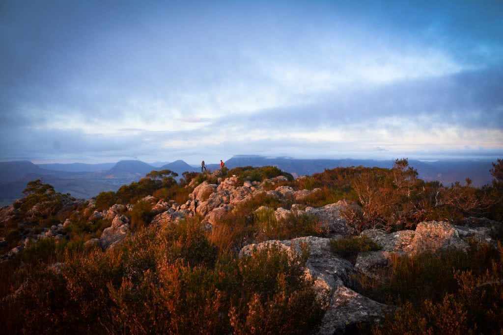 The 5 Best Sunrise Spots Near Brisbane, Lisa Owen, Hikes_Mt Maroon, people, orange, rocks, dawn light, cloudy, moody