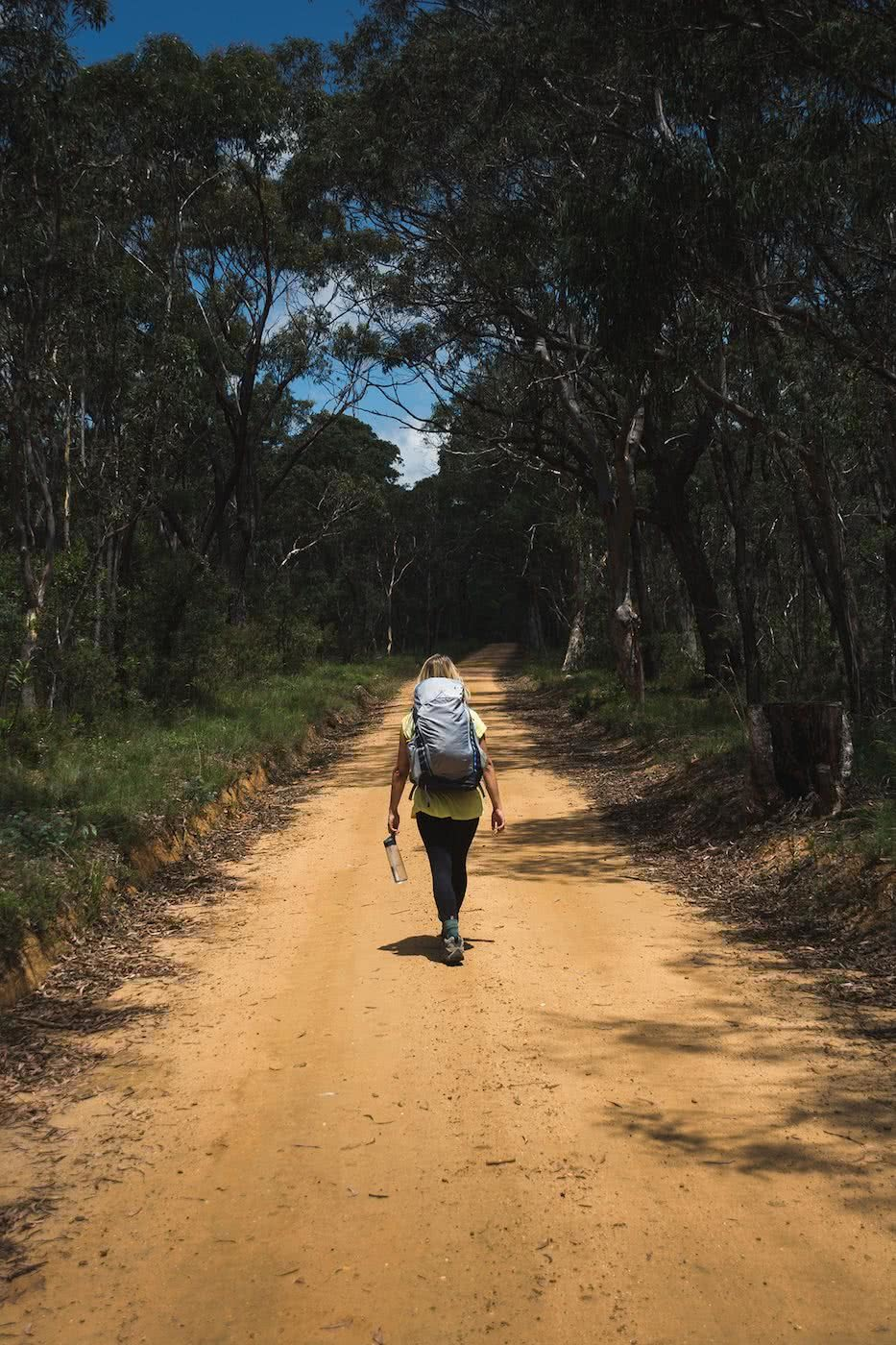 Escape From The Urban // Blackheath To Acacia Flat (NSW), Matt n Kat Pearce, Kat on fire trail, hiker, backpack, trees