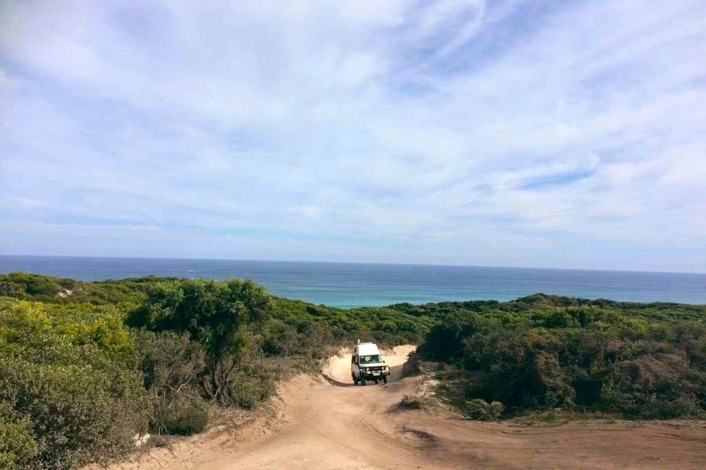 Troopy Travels // Chasing Sunsets From Byron Bay To The Ningaloo Reef, Alice Forrest, Boranup-WA, photo by Angie Barrack, dirt road, sandy, off road, van ocean