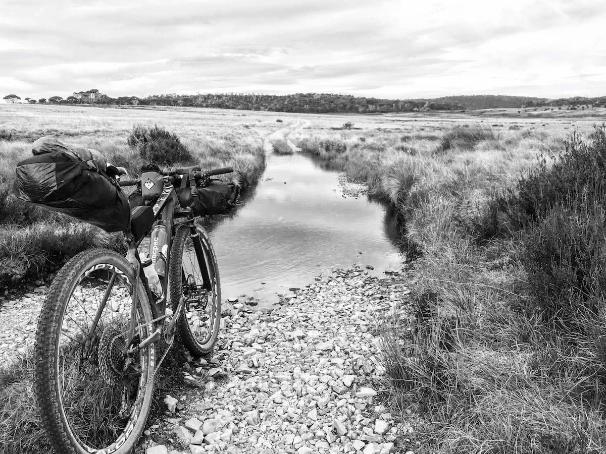 mattie gould, bikepacking, jagungal wilderness, nsw, black and white, photo essay, puddle