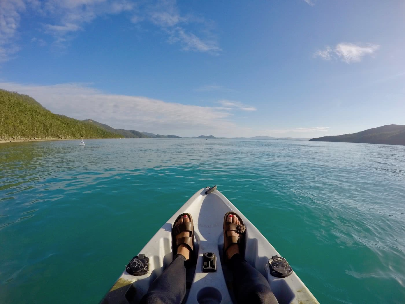 Camping The Whitsundays // Cairn Beach Campground (QLD), Solaye Snider, canoe, Birkenstocks, legs, feet, water