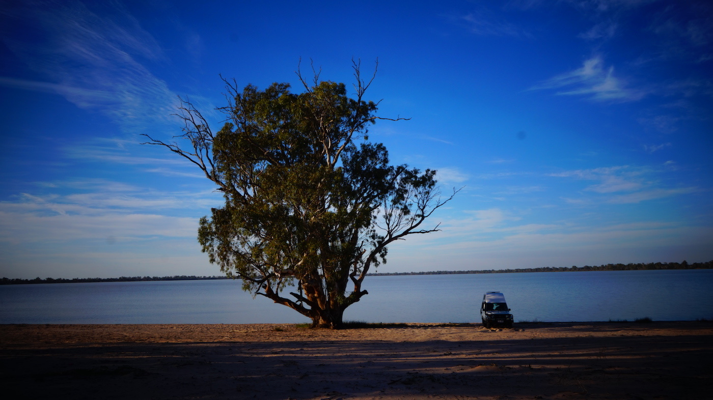 Troopy Travels // Chasing Sunsets From Byron Bay To The Ningaloo Reef, Alice Forrest, Lake Benanee SA, photo by Angel Grimaldi, tree, view, van life, water